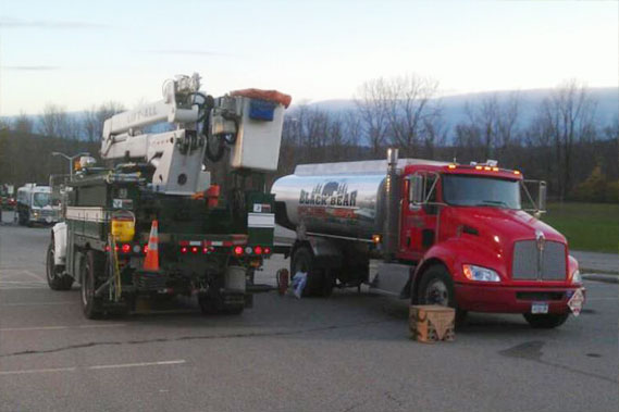 Photo of a truck receiving fleet fueling on the road from Black Bear Fuel Oil in Harris, NY